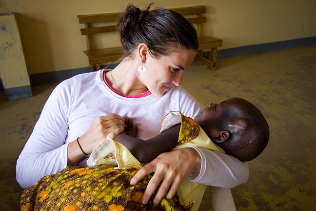 Julie with a patient at CURE Uganda